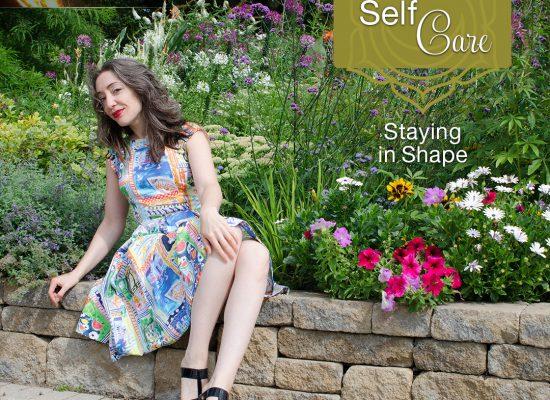 Woman sitting among flowers
